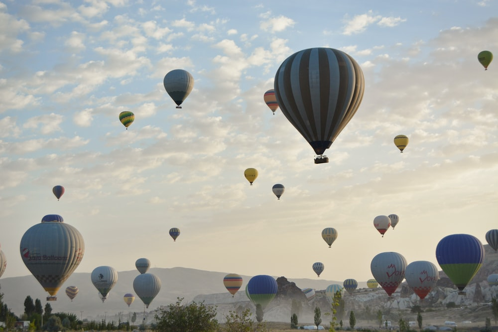 hot air balloons in the sky during daytime