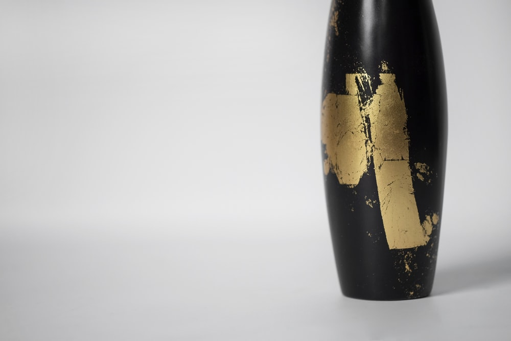 black and gold glass bottle