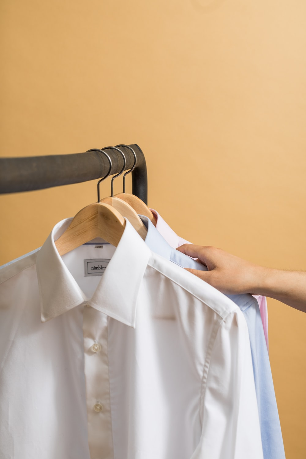 white button up shirt on clothes hanger