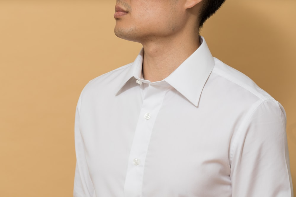 man in white button up shirt