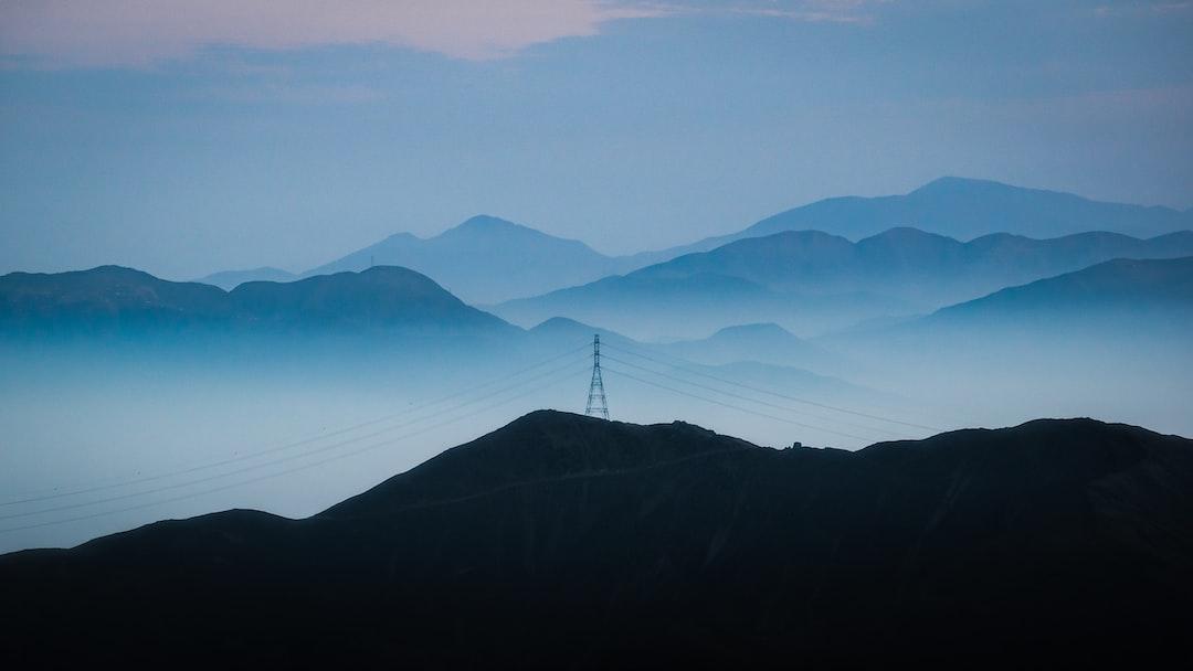 Mountain Range Under Blue Sky During Daytime - unsplash