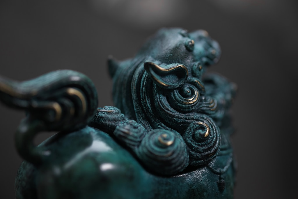 blue and green ceramic figurine