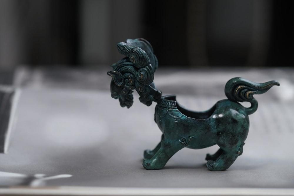 black dragon figurine on white table