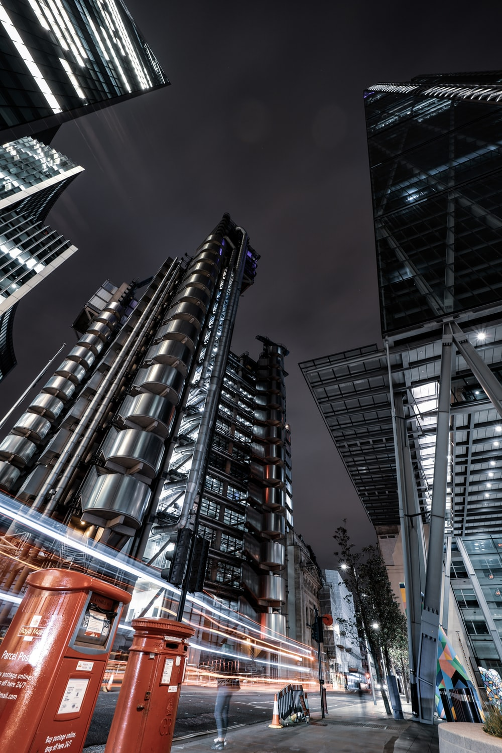 low angle photography of high rise building during night time