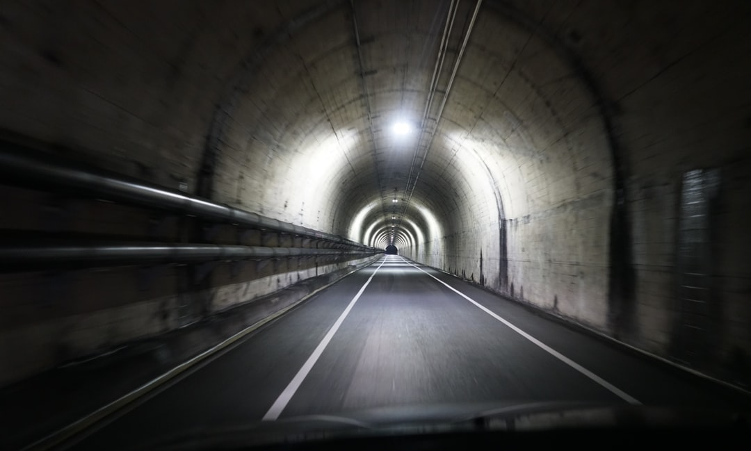 Tunnel With Light Turned On During Daytime - unsplash