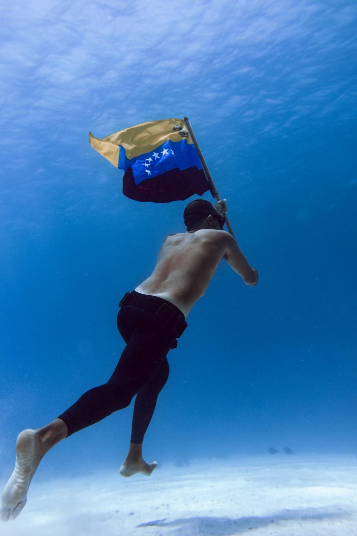 man in blue shorts under water
