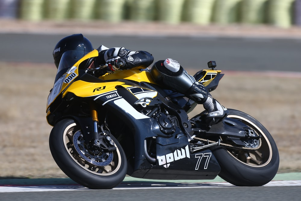 yellow and black sports bike