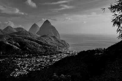 grayscale photo of mountain near body of water st. lucia teams background