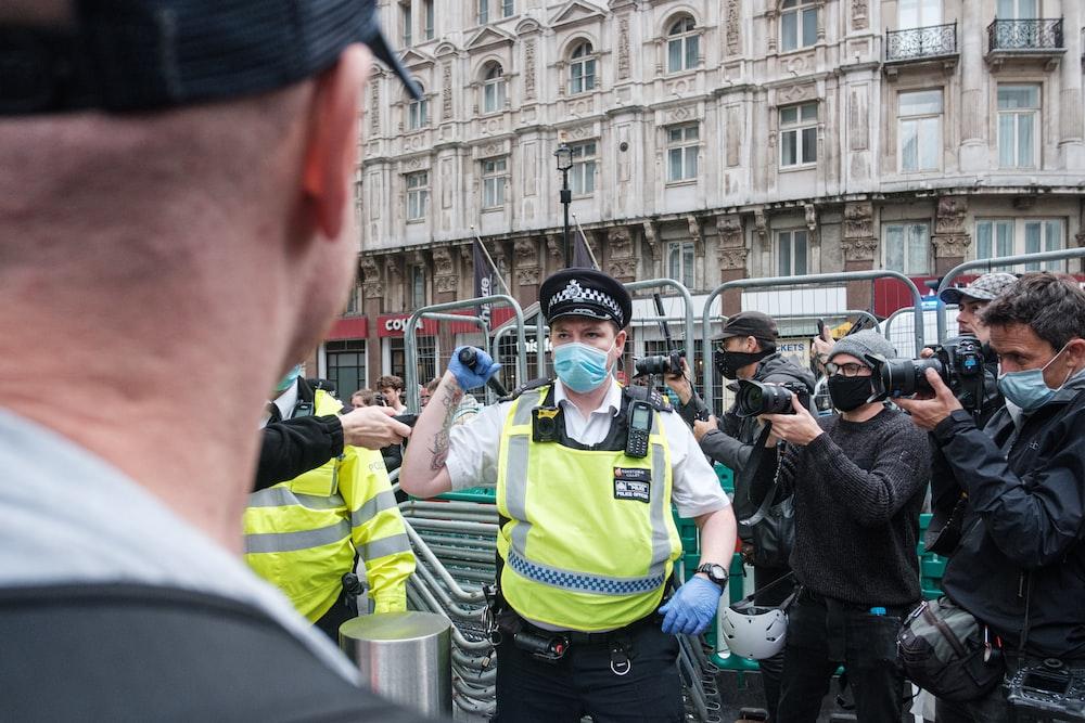 man in green crew neck shirt wearing black sunglasses