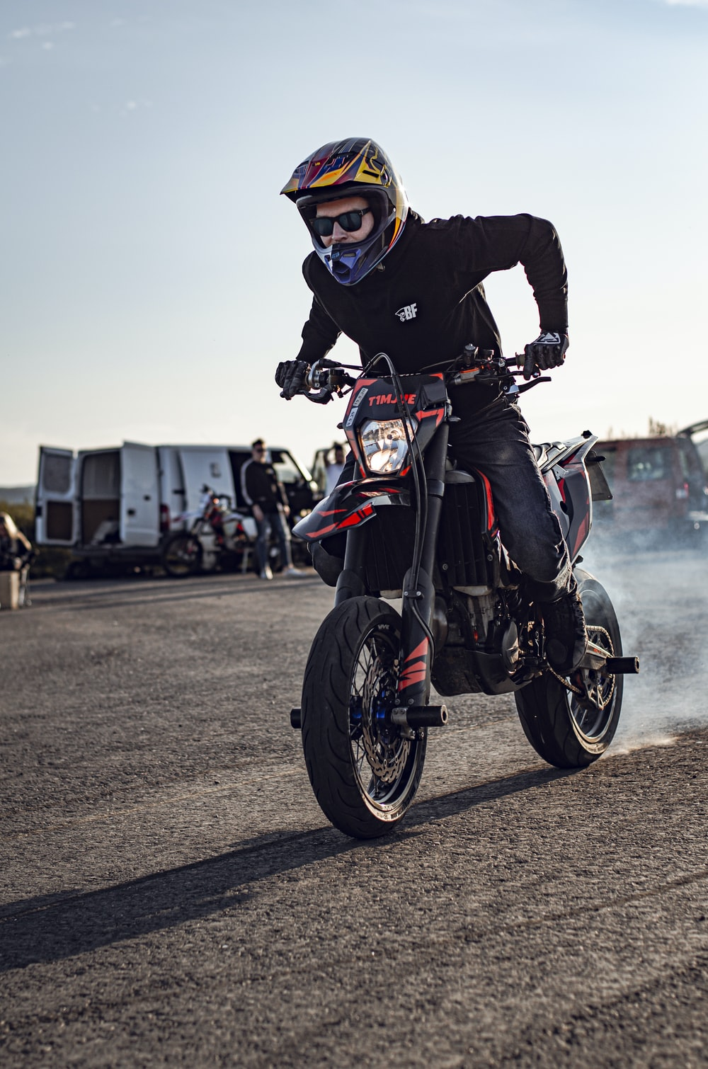 man in black and red motorcycle suit riding motorcycle