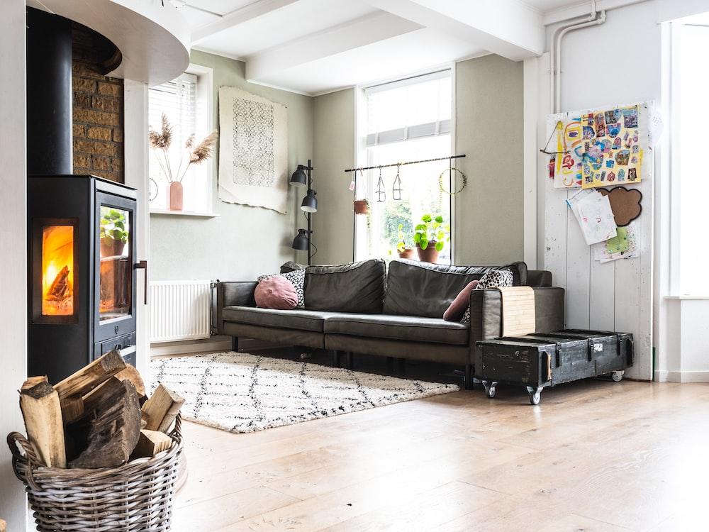 black and white sofa near brown woven basket