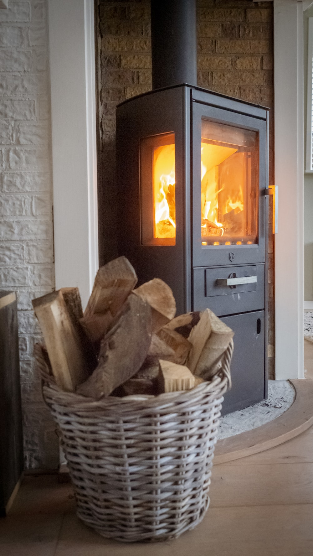 brown wooden fire place in front of white wooden door