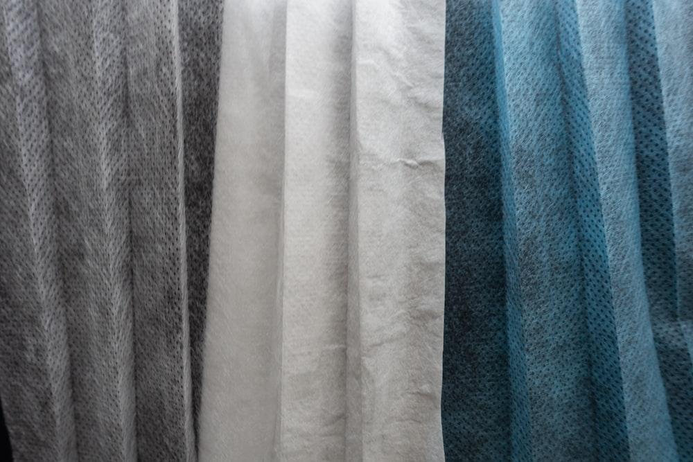 white textile on blue towel