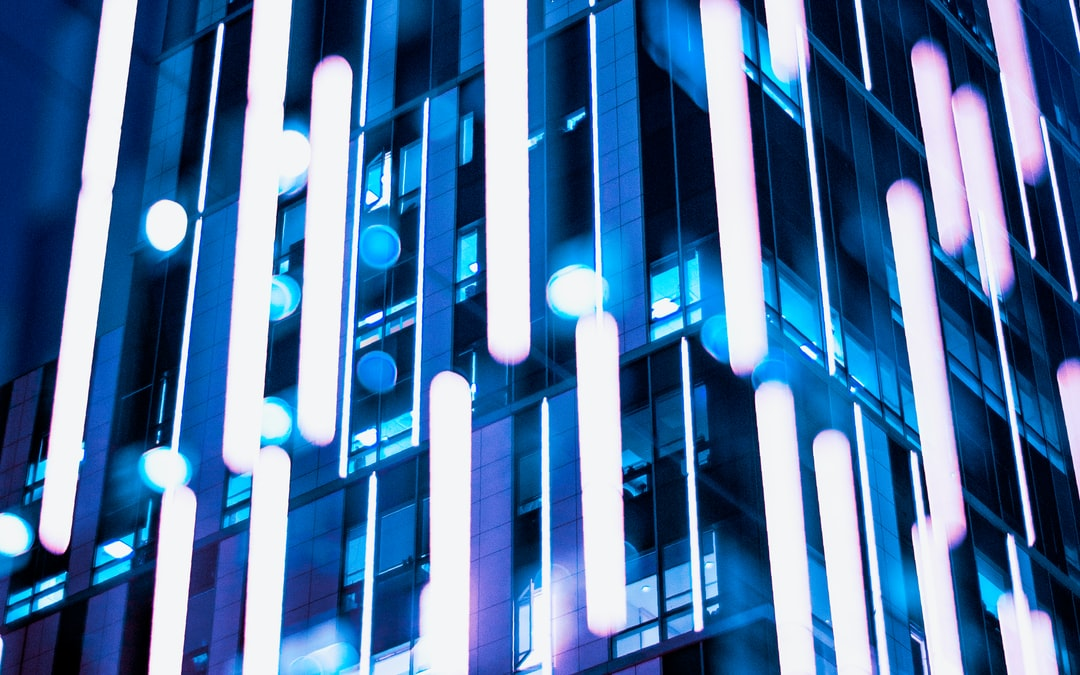 Bright Blue Lights In Front of A Building. - unsplash