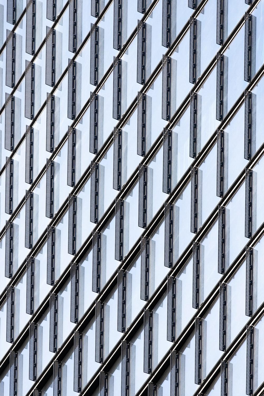 grey metal fence during daytime