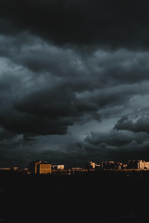city skyline under dark clouds