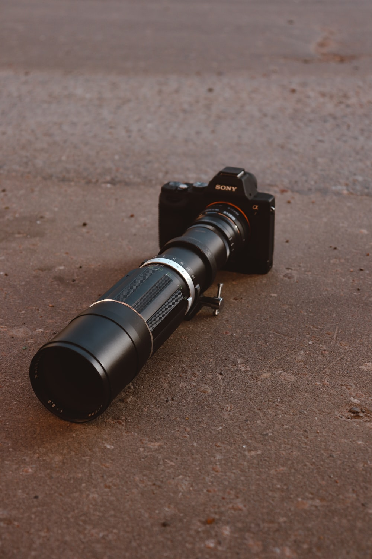 black dslr camera on brown soil