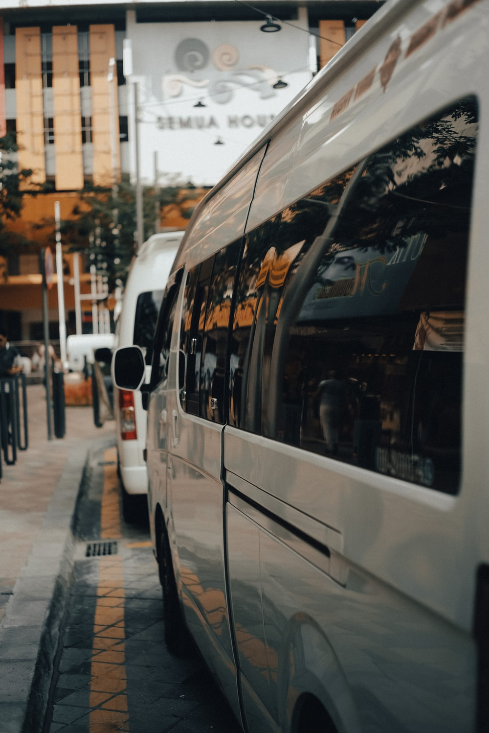 white bus on the street during daytime