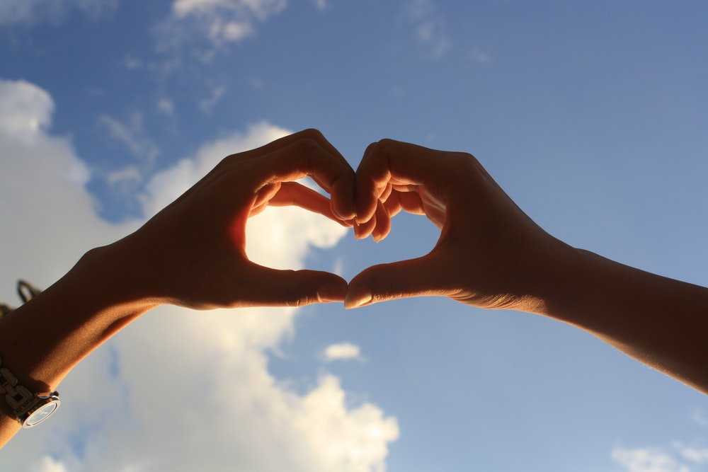 2 hands forming heart shape