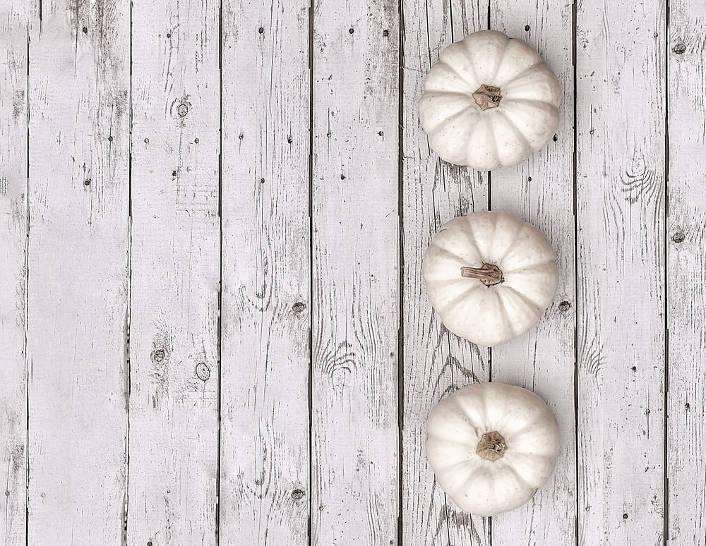 white garlic on gray wooden surface