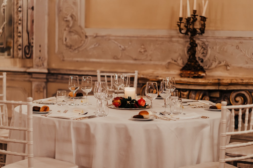 white table cloth with plates and glasses