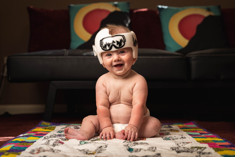 baby wearing white and red headband