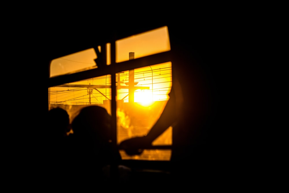 silhouette of people sitting on chair during sunset