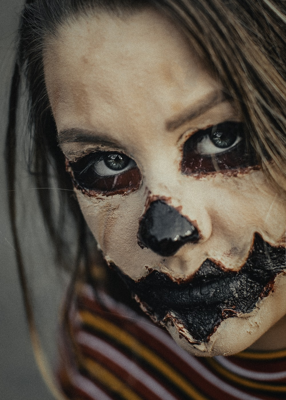 woman with black and red face paint