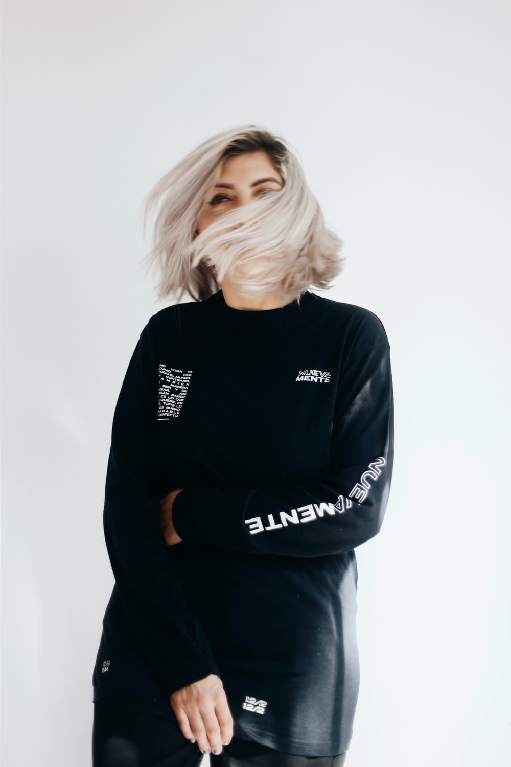 woman in black and white adidas sweater
