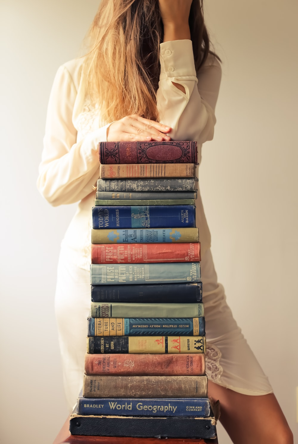 woman in white long sleeve shirt reading books