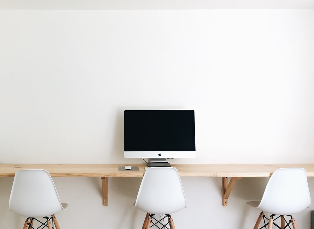 Black Flat Screen Computer Monitor On Brown Wooden Table - unsplash