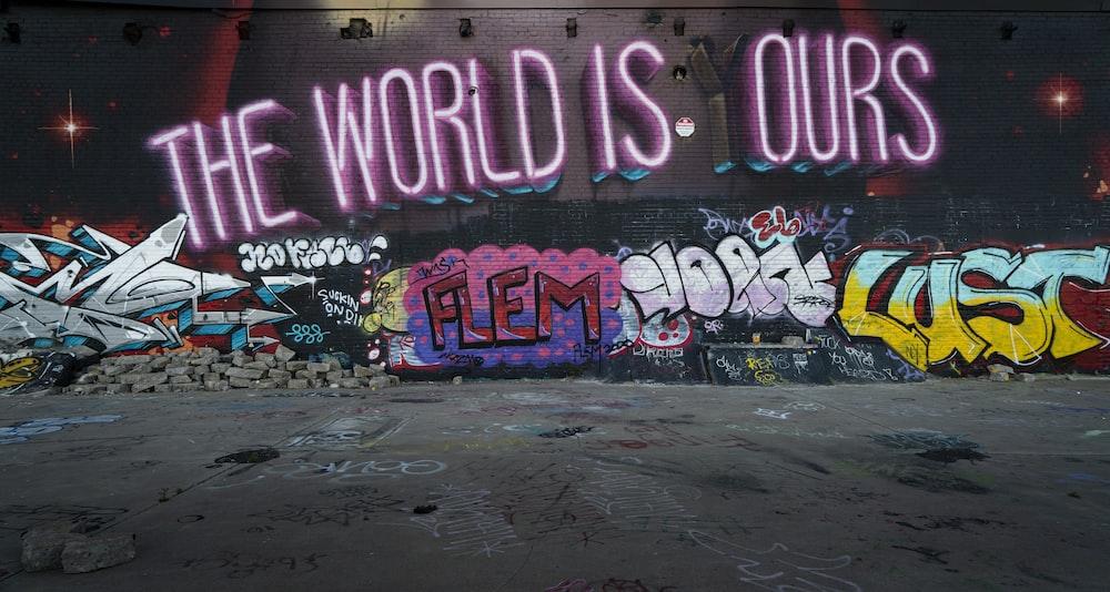 purple and pink love me love me wall graffiti