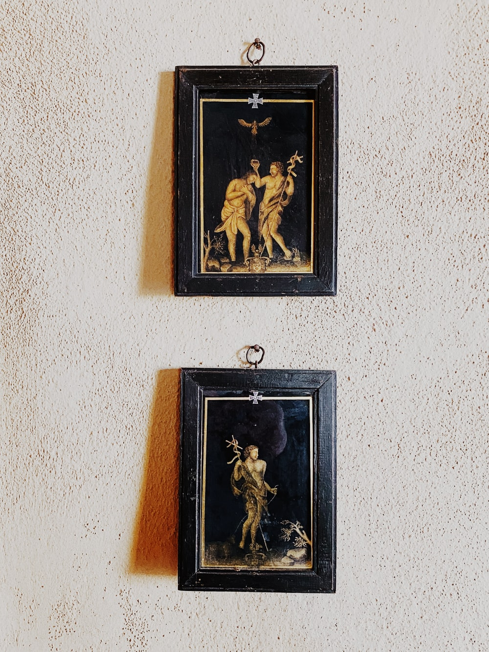 brown wooden framed religious painting