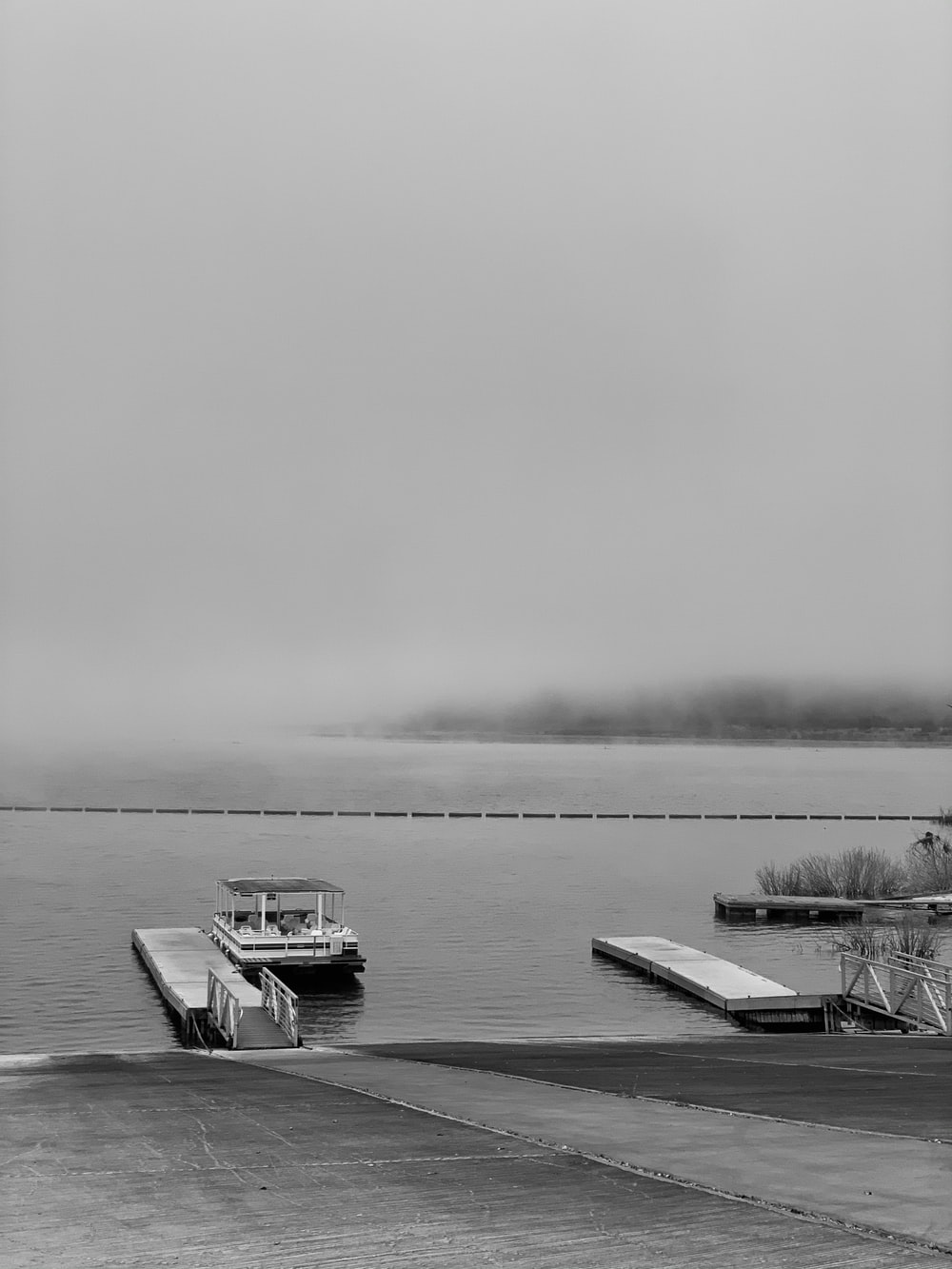 grayscale photo of boat on sea