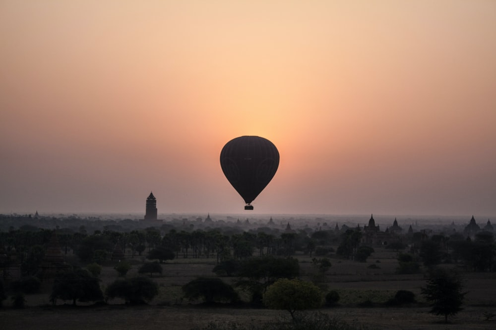 silhouette of hot air balloon during sunset