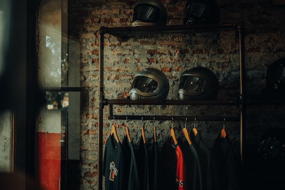 black helmet on black steel rack