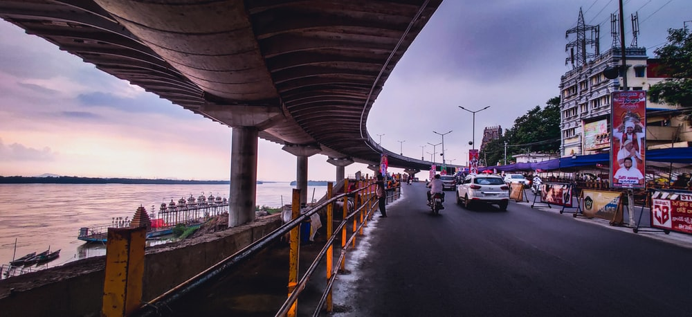 cars on road under bridge during daytime