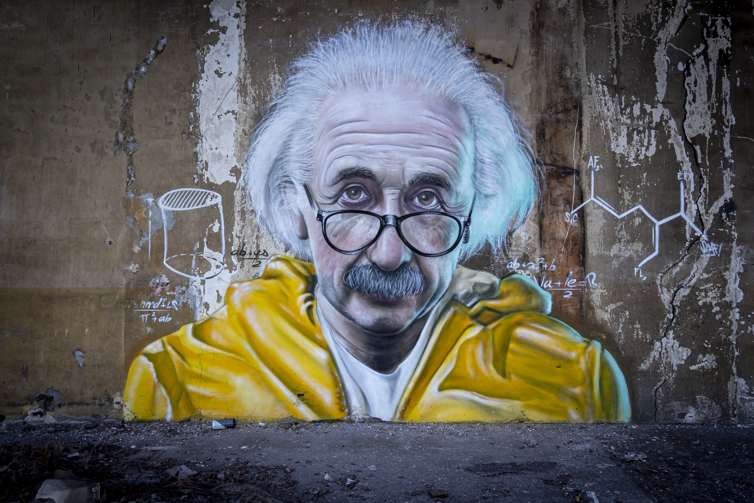 approach creativity like a scientist man in yellow and blue hoodie wearing eyeglasses