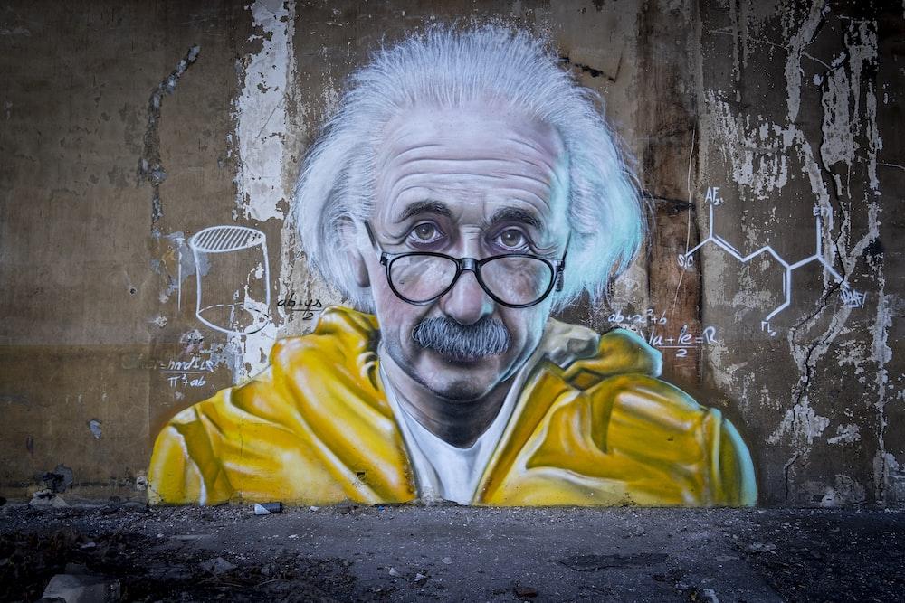 man in yellow and blue hoodie wearing eyeglasses