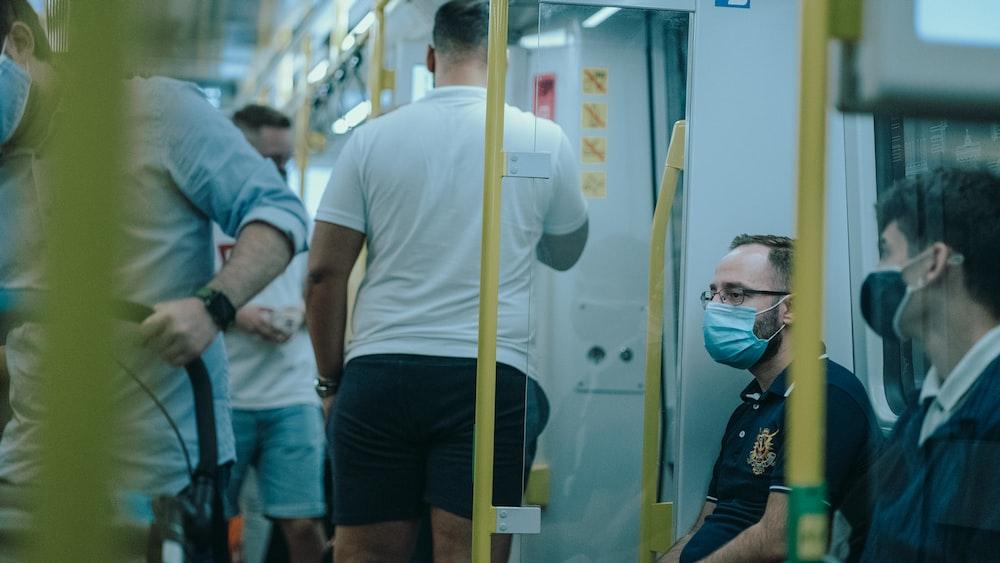 man in yellow crew neck t-shirt wearing white mask