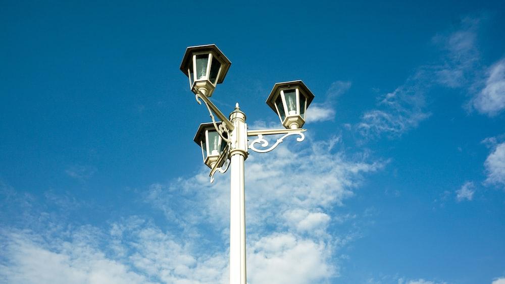 white street light under blue sky during daytime