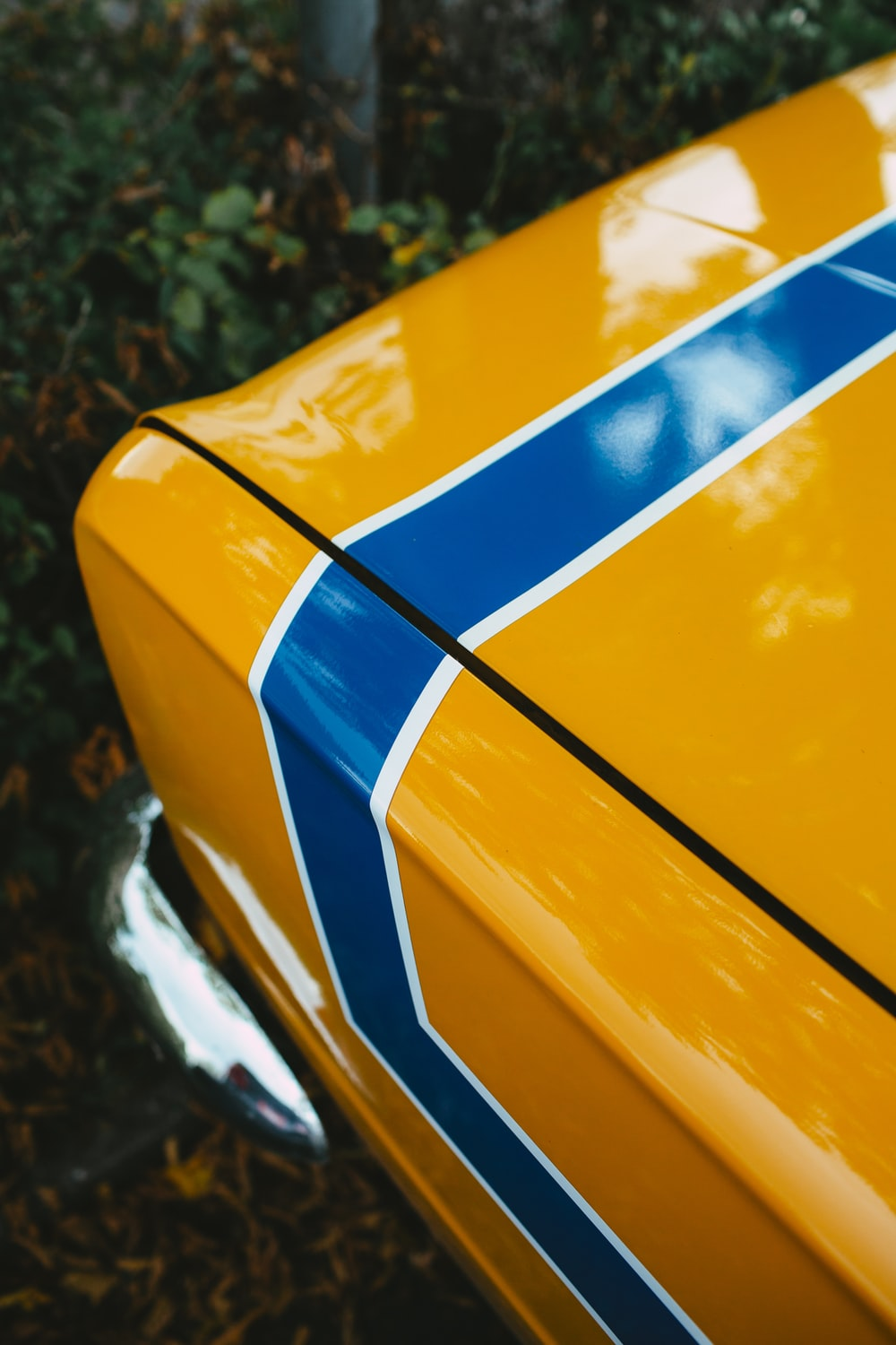 yellow blue and white car