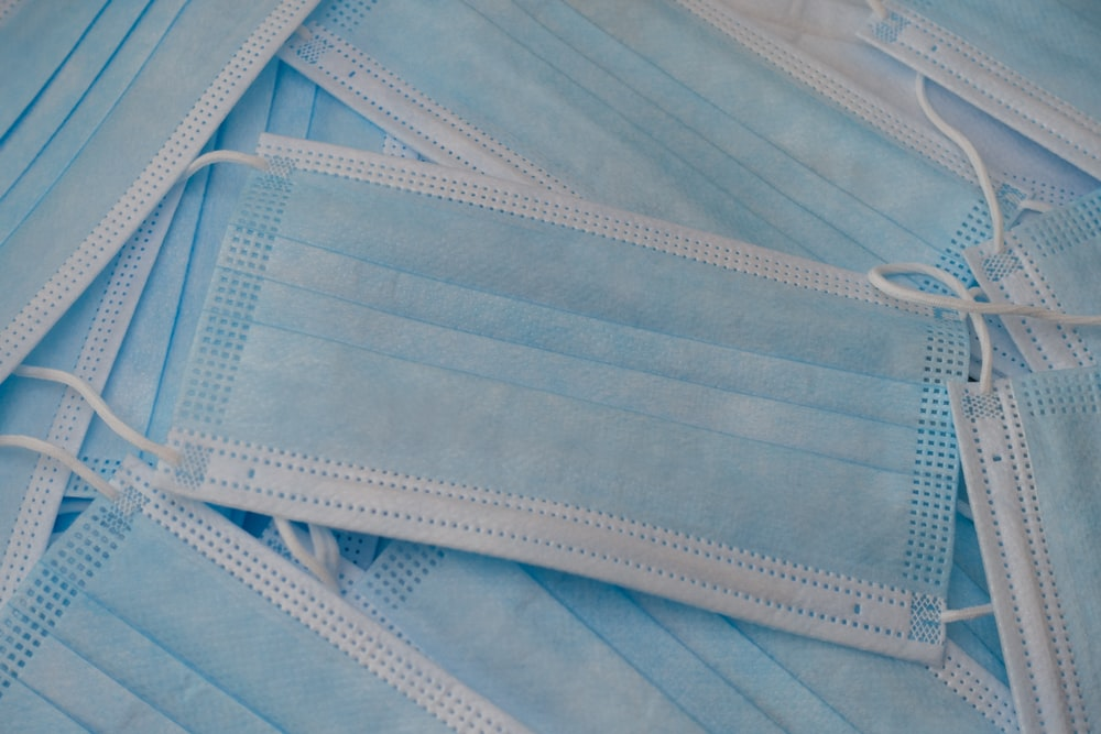white and blue striped textile