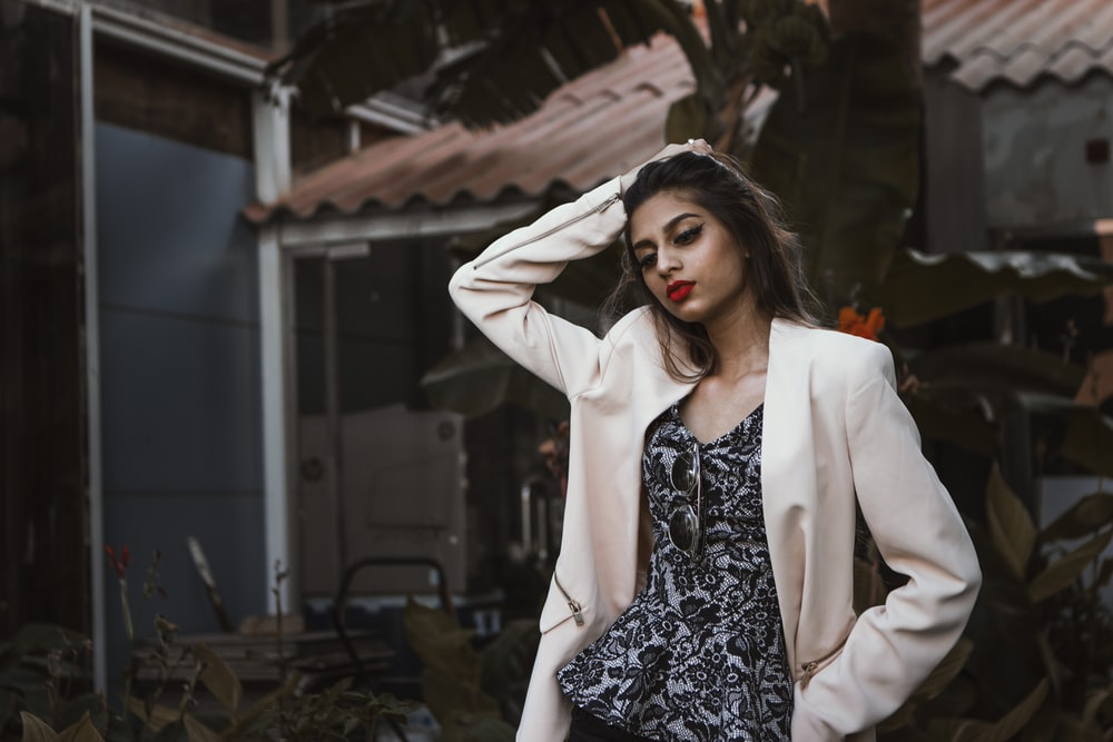 woman in white blazer standing