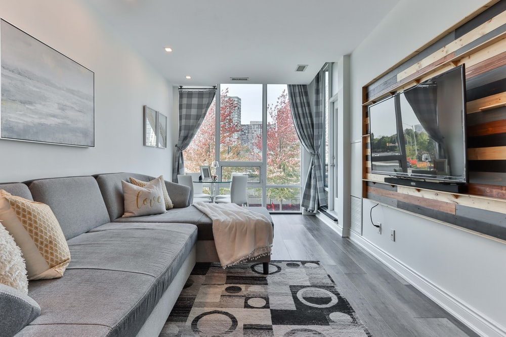 gray couch near glass window