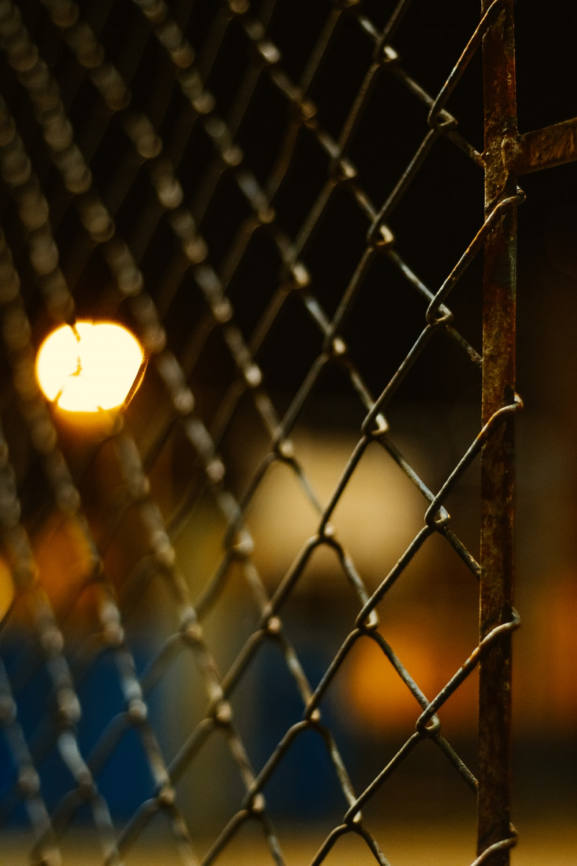 grey metal fence during night time