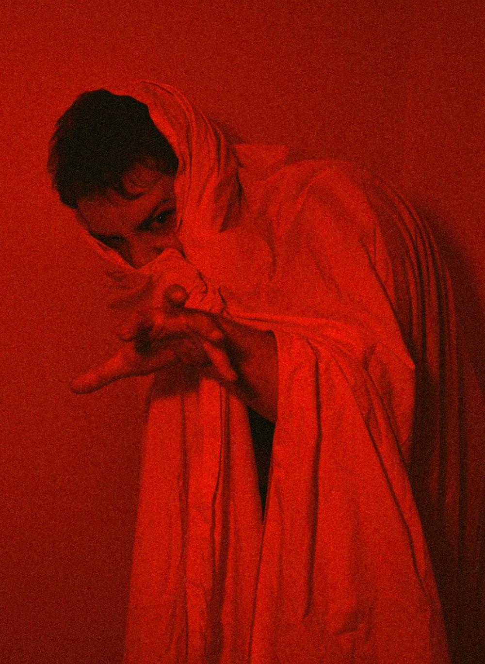 man in red hoodie standing