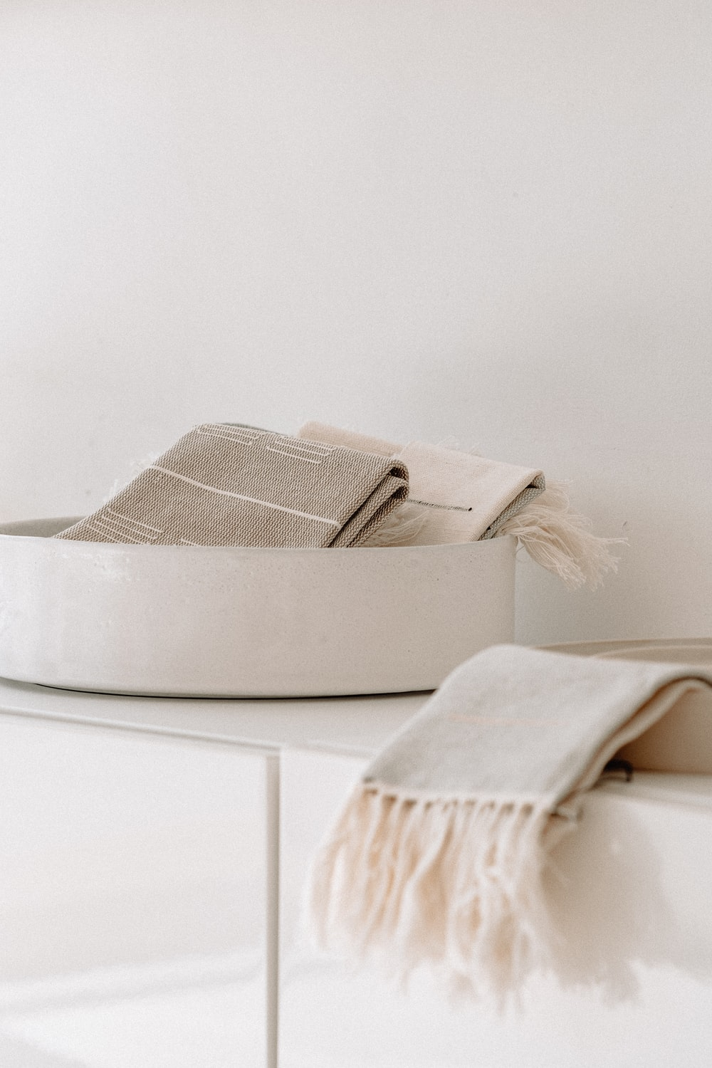 white and gray bed pillow