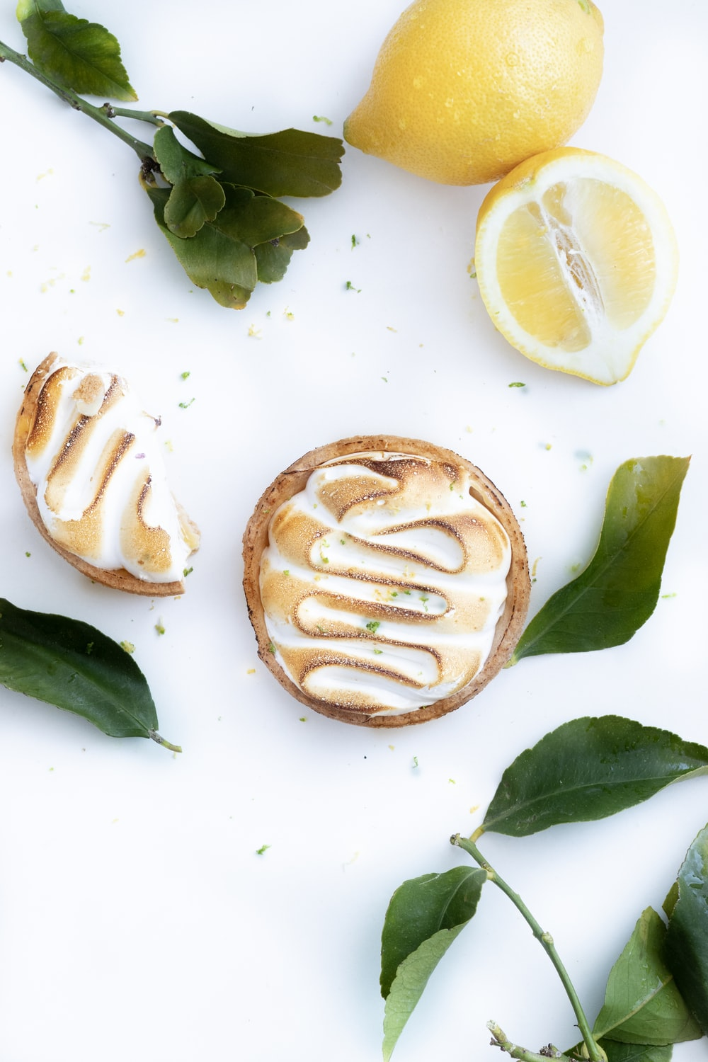 bread with sliced lemon on white table