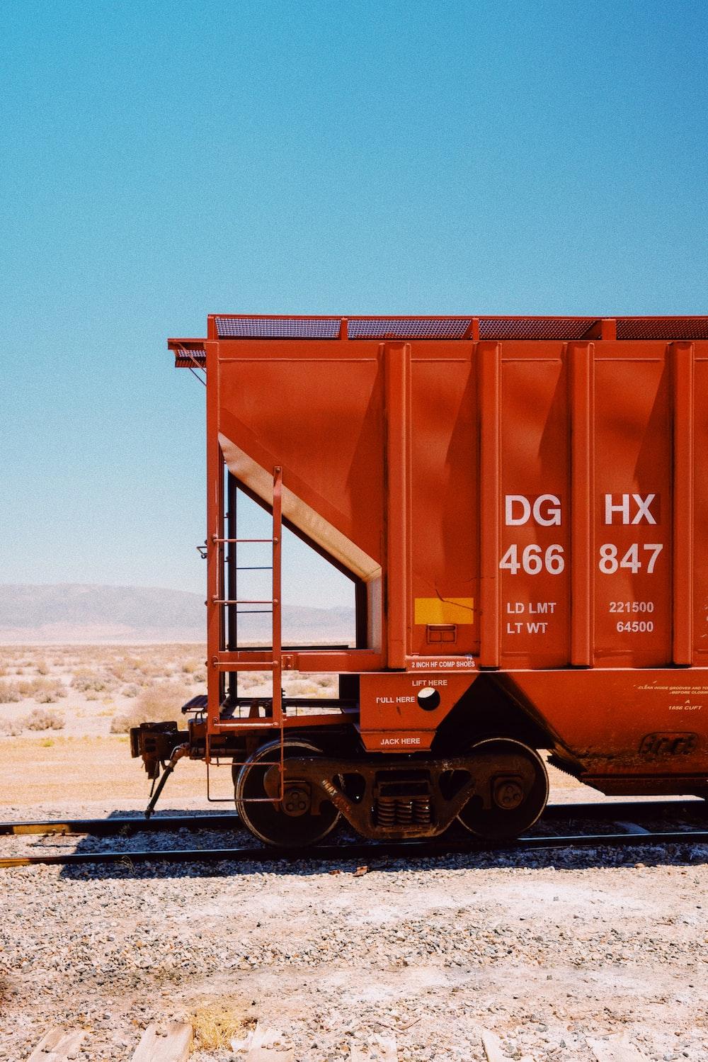 brown metal train on rail tracks during daytime